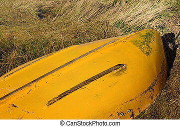 Upturned row boat - Upturned yellow row boat