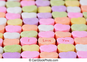 I Love You on Candy Hearts - Closeup of the words I Love You...