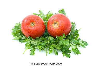 Two ripe fresh tomatoes over some parsley