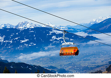 Cable car on the ski resort in Austria. On the background...