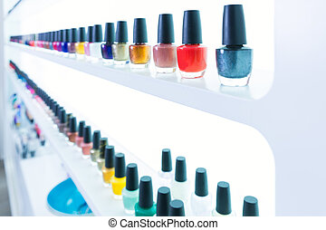 colorful nail polish colors in a row at nails saloon on...