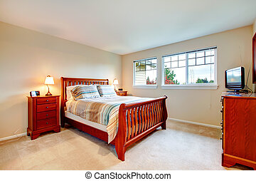 Warm colors bedroom with wood furniture