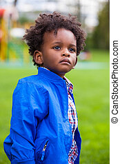 Outdoor portrait of a little african american boy - Black - children - people
