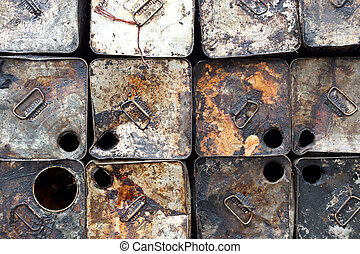 old oil tin packing is stacked outdoors - Many old oil tin...