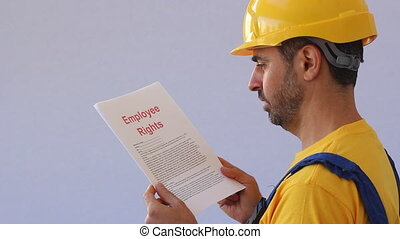 employee reading his rights - employee rights documents