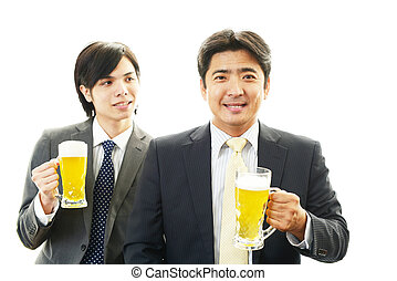 Men drinking beer - Smiling Asian men drinking beer