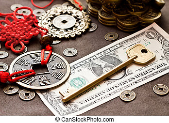 Key on dollar with feng shui symbol and coins