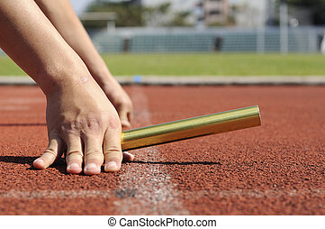 Relay-athletes hands starting action. - Relay-athletes hands...