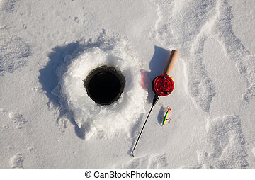 Ice fishing rod with the lure by the hole