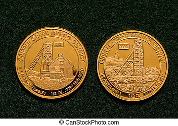 Two One-half Ounce Pure Gold Coins - Two one-half ounce pure...