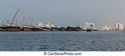 Sharjah port - SHARJAH, UAE - OCTOBER 29: Sharjah - port, on...