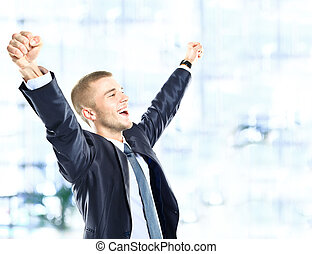 Successful man celebrating with arms up