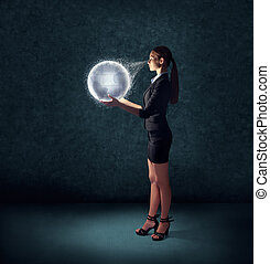 business woman holding glowing planet earth
