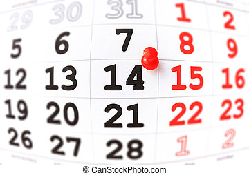 Calendar and red pushpin on 14 February. Valentine's day...