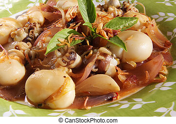 Spicy asian squid dish traditional cuisine on plate
