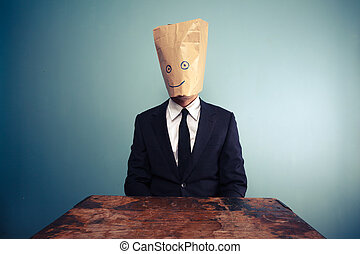 Businessman with bag over head
