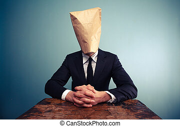 Relaxed businessman with bag over head