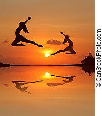ballet girl in sunset beach Silhouette