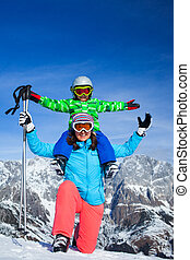 Ski, winter, snow, skiers, sun and fun - family enjoying...