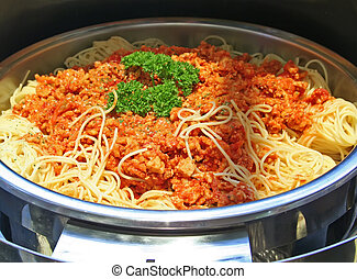 Spaghetti with sauce served in a mettal buffet tray