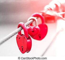 Lock in hart shape - Red Locks in hart shape on rope bridge