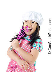 Little asian girl with kitchen ware concept on white...