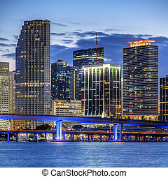 CIty of Miami Florida, illuminated business and residential buildings and bridge on Biscayne Bay