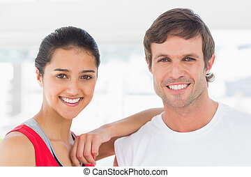Closeup of a fit smiling couple in exercise room - Closeup...