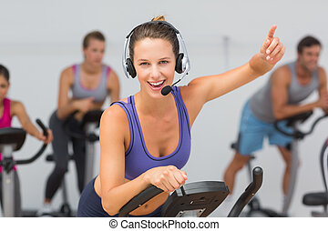 Fit people working out at spinning class - Portrait of fit...