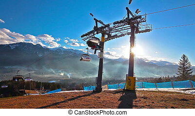 mountain landscape and skiers on a ski lift pov