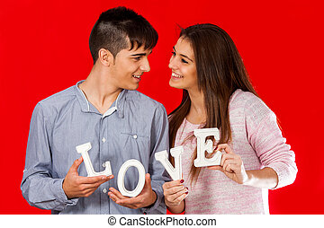 Young couple holding block love letters - Young teen couple...