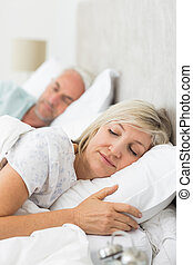 Mature couple sleeping with eyes cl - Closeup of a mature...