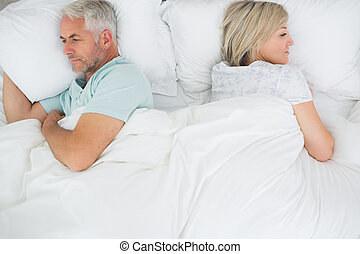 Mature couple lying in bed - High angle view of a mature...