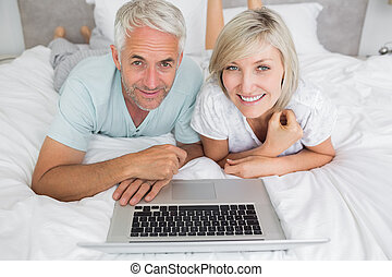 Relaxed mature couple using laptop - Portrait of a relaxed...