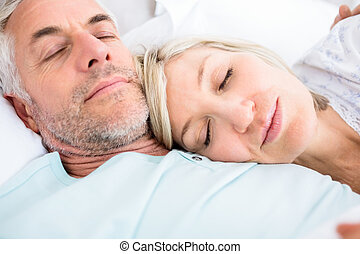 Loving mature couple sleeping in bed - Closeup of a loving...