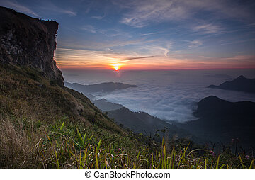 sunset - Sunrise scene with the peak of mountain and...