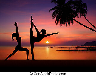 Silhouette of Yoga woman in sunset