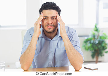businessman suffering from headache - Portrait of...