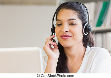 Businesswoman using headset in office