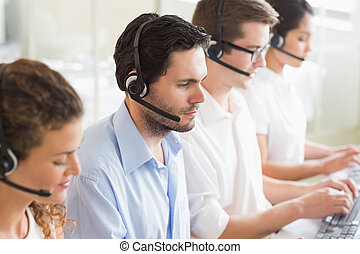 Customer service agents working in office