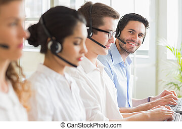 Business people working in call center - Portrait of happy...