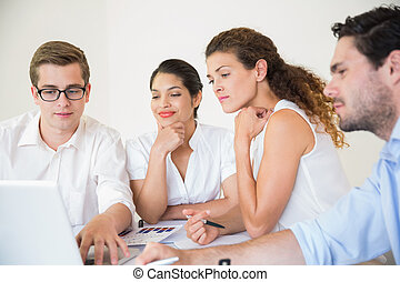 Business people working on laptop in office meeting