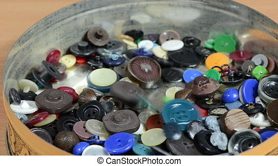 buttons fall box - Closeup of different colorful buttons...