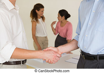 Business people shaking hands - Cropped image of business...