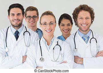 Happy nurses and doctors in hospital - Portrait of happy...