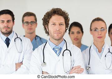 Confident doctors and nurses - Portrait of confident doctors...