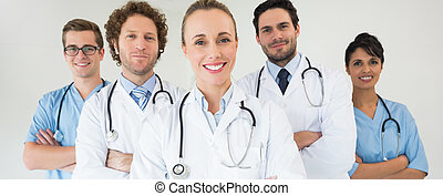Happy medical team - Portrait of happy medical team standing...