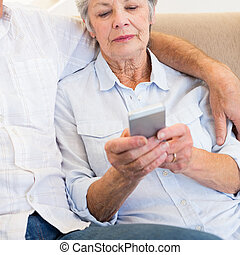 Woman reading text message on smartphone