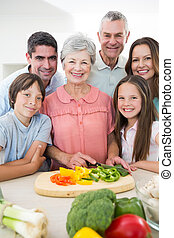 multigeneration family preparing food at counter - Portrait...