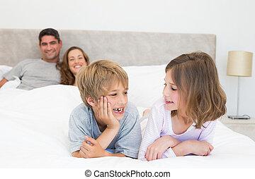 Happy siblings looking at each